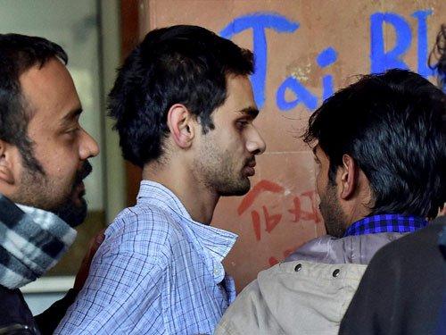 Two JNU students surrender after standoff
