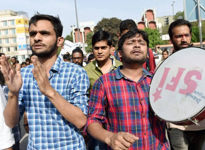 JNU students protest seat cut in courses outside UGC office