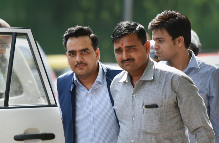 Delhi-based journalist Upendra Rai (L) being produced in a CBI court in New Delhi on Friday. Rai has been arrested for allegedly indulging in dubious financial transactions and getting an airport access pass made by the Bureau of Civil Aviation Security (