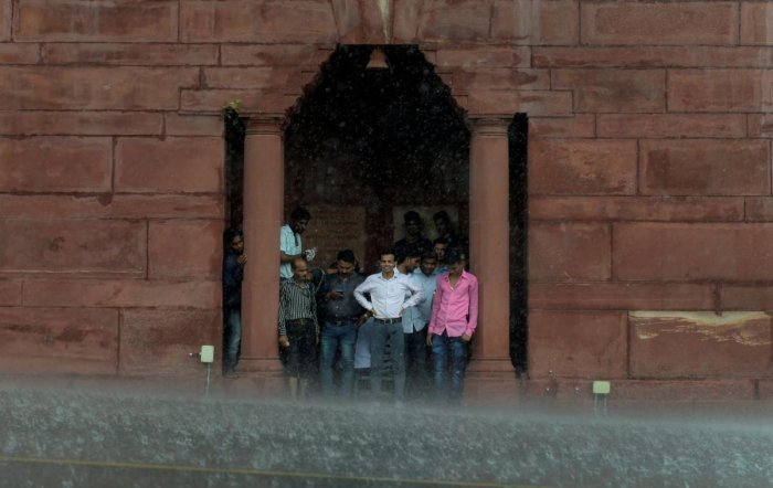 The south-west monsoon hit New Delhi this week with light rain on Monday and heavy showers on Thursday, bringing respite not only from the scorching heat but also from the pollution which had peaked to unexpected levels this month. (PTI Photo)