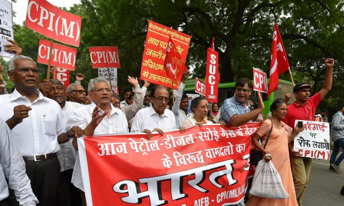 CPM leader Sitaram Yechury, CPI leader D Raja along with other leaders shout anti-government slogans during the 'Bharat Bandh', in New Delhi on Monday. (PTI)