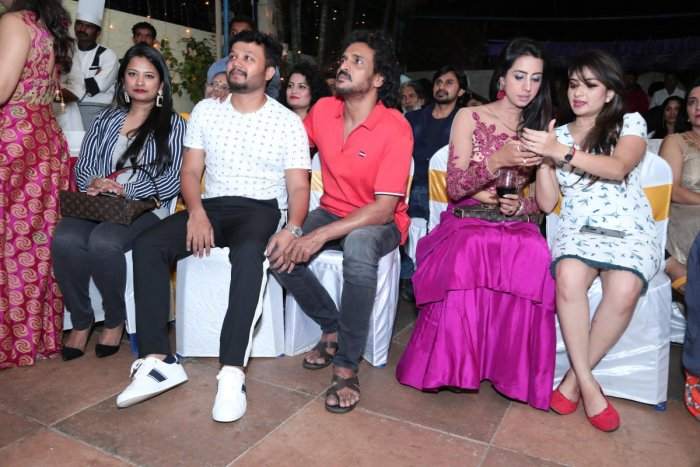 Ganesh (in white) and Sanjjanaa Galrani (in bright pink) were among some of the guests at the event.