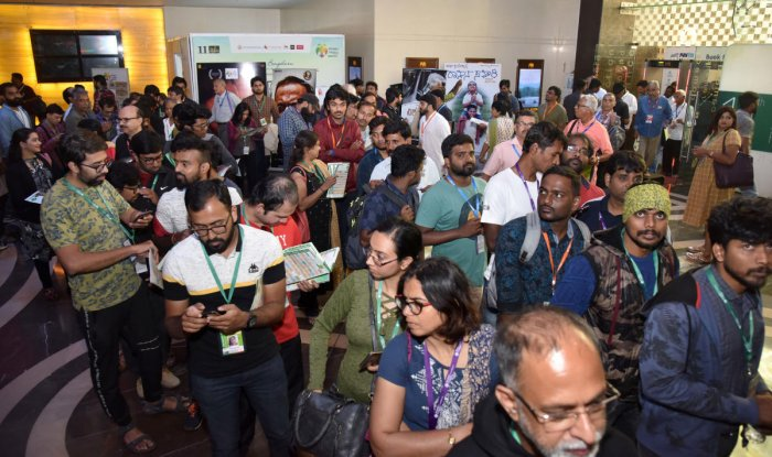 Audience standing in queue to watch their favourite films at BIFFes 2019. DH Photo by SK Dinesh