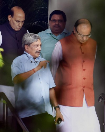 In this file photo taken on July 22, 2016, Defence Minister Manohar Parrikar is seen with Union ministers Rajnath Singh and Arun Jaitley, in New Delhi. PTI