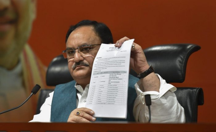 Union Minister and BJP leader JP Nadda shows the first list of candidates for the upcoming Lok Sabha elections, at party office in New Delhi, on Thursday. (PTI Photo)