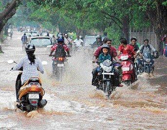 Rain wreaks havoc in Assam, cools Delhi