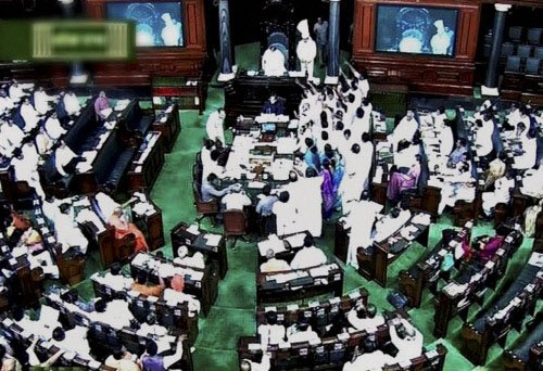 Ruckus in Parliament over communal riots in UP