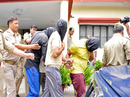 Delhi gang-rape convicts fight in jail