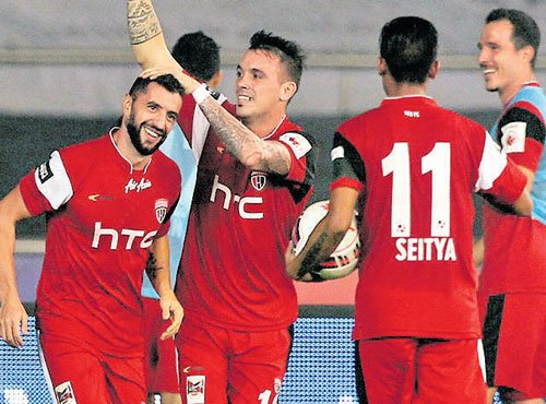 NUFC strike late to hold Delhi