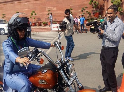 Cong MP rides on Harley to Parliament on Women's Day