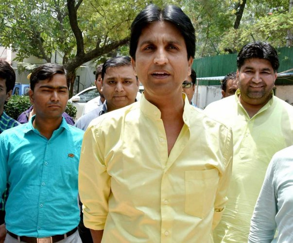 Vishwas hits out at AAP's 'palace politics', posters call him 'traitor'