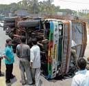 Traffic pile-up as container overturns on Mysore Road