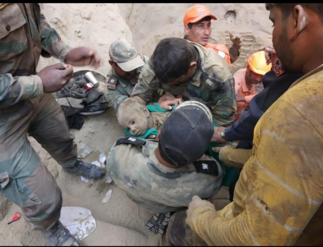 First image of 18 months old boy rescued from a 60 feet deep borewell in Haryanas Hissar on Friday. DH photo