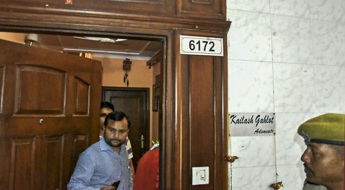 Income Tax officials conduct a raid at Delhi transport minister Kailash Gahlot's residence in connection with an alleged tax evasion case in New Delhi on Wednesday. (PTI Photo)