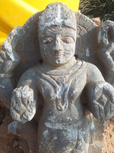 The statue is not made of black stone, which is typically used to make idols.