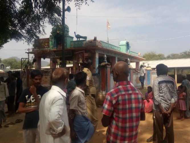 People outside the temple at Sulvadi village in Hanur taluk, Chamarajanagar district. (DH Photo)