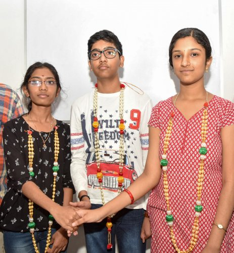 R Keerthana, M S Yashas and Adithi A Rao, students of Sadvidya High School, in Mysuru on Monday.
