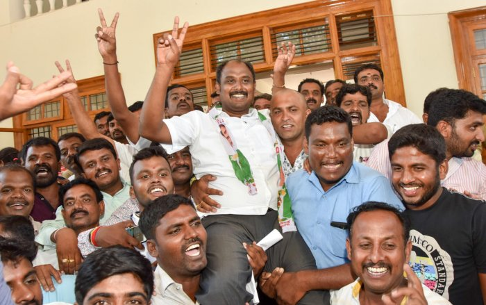 Party workers celebrate the victory of Ashwin Kumar, JD(S) candidate from T Narasipur Assembly constituency, in Mysuru on Tuesday. DH PHOTO