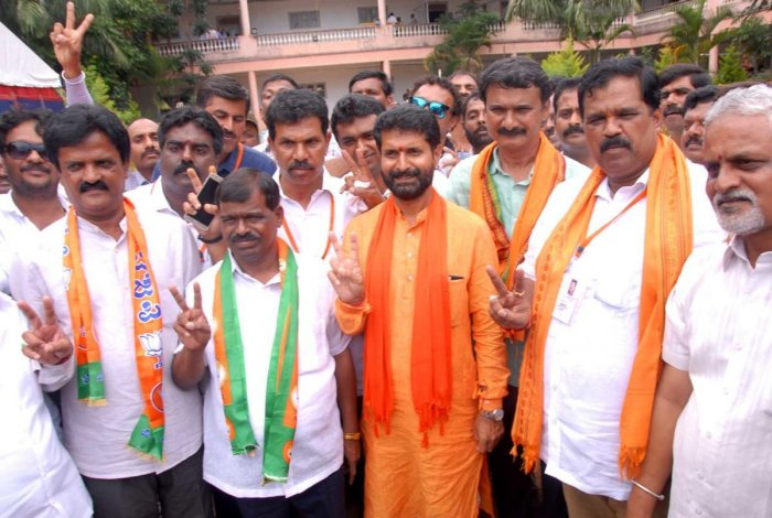Chikkamagaluru BJP candidate C T Ravi shows the victory sign after winning the election in Chikkamagaluru.