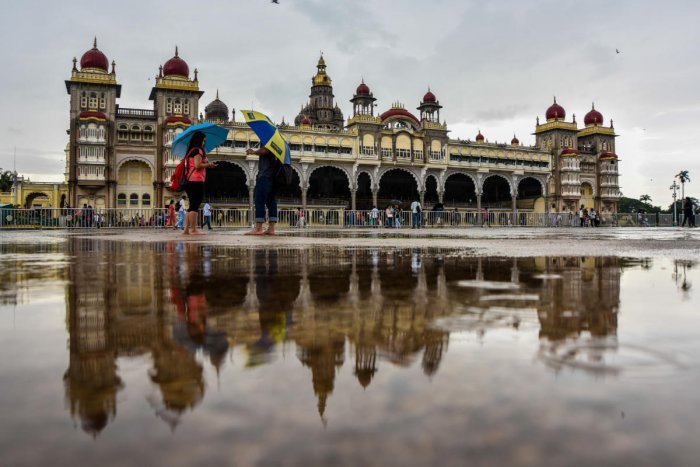 The Ambavilas palace is reflected in rain water. Volvo buses will ferry the tourists to nine palaces in and around the city. The fare includes food, entry fee to the palaces and bus charge. DH file photo