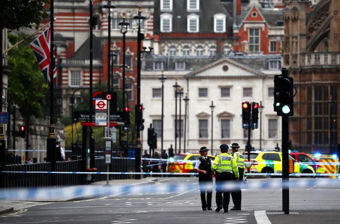Police stand in the street after a car crashed outside the Houses of Parliament in Westminster, London. Reuters photo