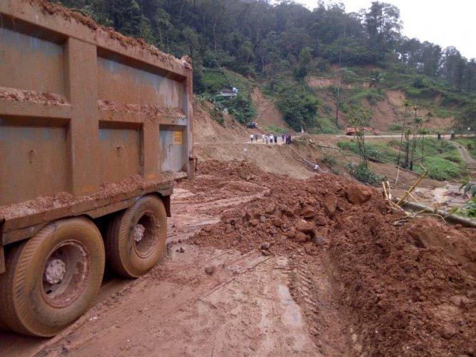 The repair work on Mani-Mysuru highway is in progress. DH PHOTO