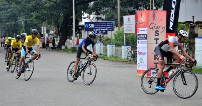 Cyclists pass through SP office in Chikkamagaluru.