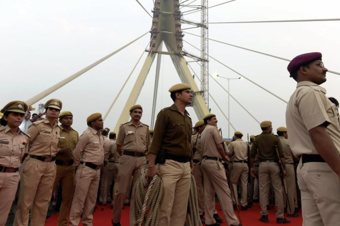 Policemen look on during the inauguration of the Signature Bridge at Wazirabad in New Delhi, on Sunday. PTI file photo