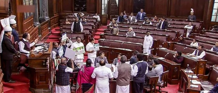 Opposition members protest in the Rajya Sabha during the Winter Session of Parliament, in New Delhi on Wednesday. PTI