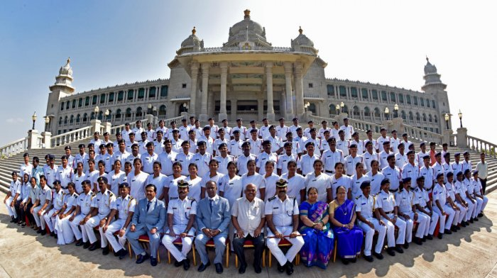 The marshalls of the House pose for a group photo with Assembly Speaker K R Ramesh Kumar in front of the Suvarna Vidhana Soudha in Belagavi on Friday, the last day of the winter session of the legislature. DH Photo/M S Manjunath