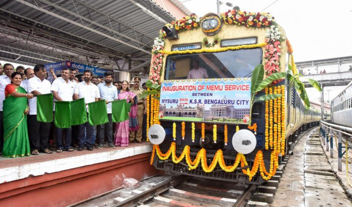 MP Prathap Simha flags off Mainline Electric Multiple Unit (MEMU) train in Mysuru on Sunday. Mayor Pushpalatha Jagannath, MLA L Nagendra, MLC Sandesh Nagaraj, Maritibbegowda, Divisional Railway Manager Aparna Garg, Additional Divisional Railway Manager Aj