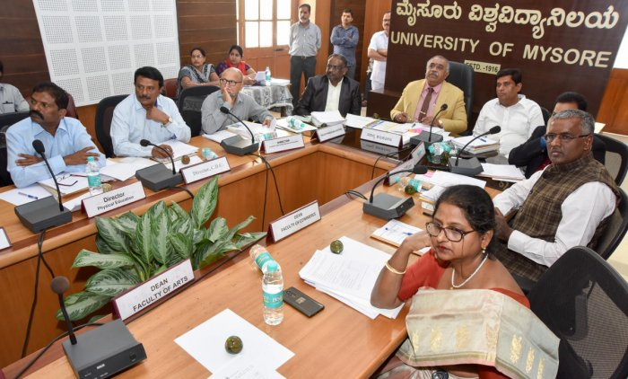 University of Mysore Vice Chancellor G Hemantha Kumar chairs the Academic Council meeting at Crawford Hall, the administrative building of the university, in Mysuru on Monday. In-charge director for Physical Education P Krishnaiah, CDC Director S Srikanta