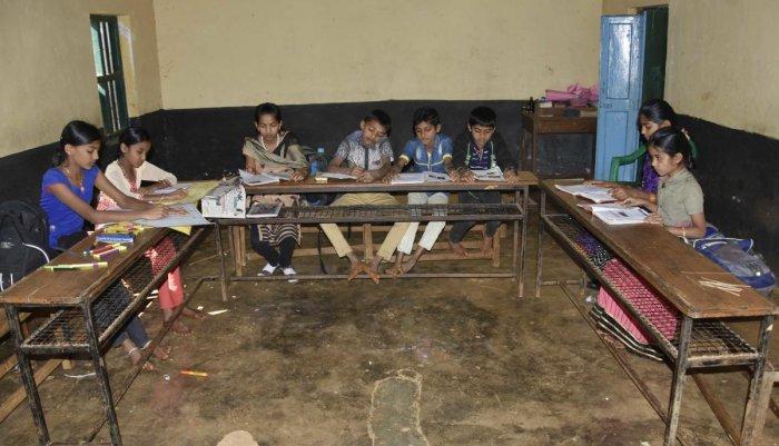 Just a handfull: A school in Aralagodu GP limits registers poor attendance. dhphoto