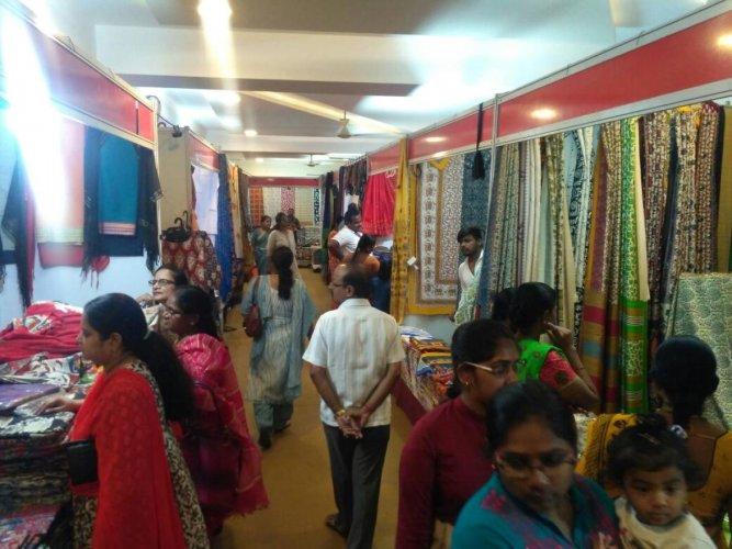 Customers take a look at the wares on display at Kala silk exhibition in Chikkamagaluru.