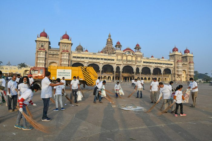 Volunteers and people's representatives take up cleaning in front of Mysuru Palace. Dh file photo