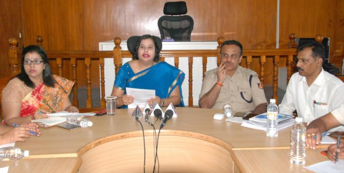 Deputy Commissioner N Manjushri during a meeting in connection with the Lok Sabha elections in Mandya on Monday. Additional DC M J Roopa, Additional SP Balaramegowda and ZP CEO K Yalakkigowda are seen. dh photo