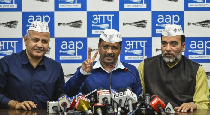 Delhi Chief Minister Arvind Kejriwal flanked by his Deputy Chief Minister Manish Sisodia (L) and AAP leader Gopal Rai addresses the media, in New Delhi. PTI photo