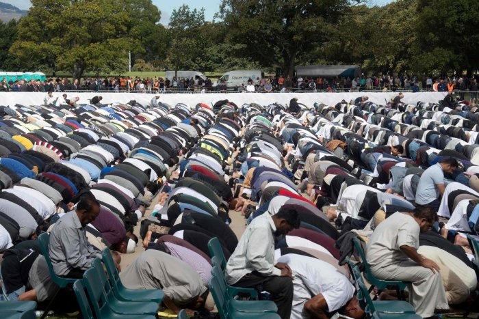 Muslims prostrate towards Mecca during congregational Friday prayers led by Gamal Fouda, imam (lead cleric) of tragedy-stricken Al Noor mosque, during a gathering for prayers and to observe two minutes of silence for victims of the twin mosque massacre at