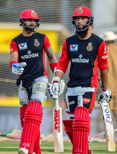 Skipper of Royal Challengers Bangalore (RCB) Virat Kohli and team-mate Moeen Ali during a practice session ahead of IPL 2019 at MAC Stadium in Chennai on Friday. PTI