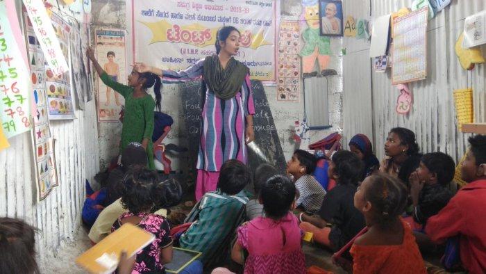 Roushan Banu, a teacher at tent school in the Shahi Nagar near Bannimantap, teaching children of migrants workers in Mysuru city.