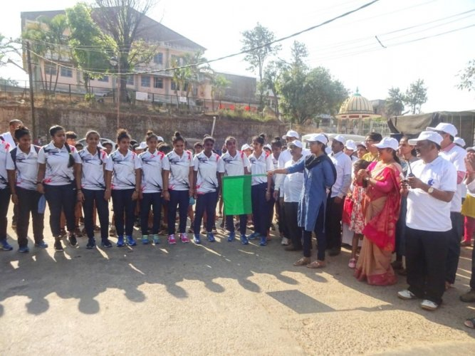 Zilla Panchayat CEO and SVEEP Committee Chairperson K Lakshmi Priya flags off a marathon in Madikeri.