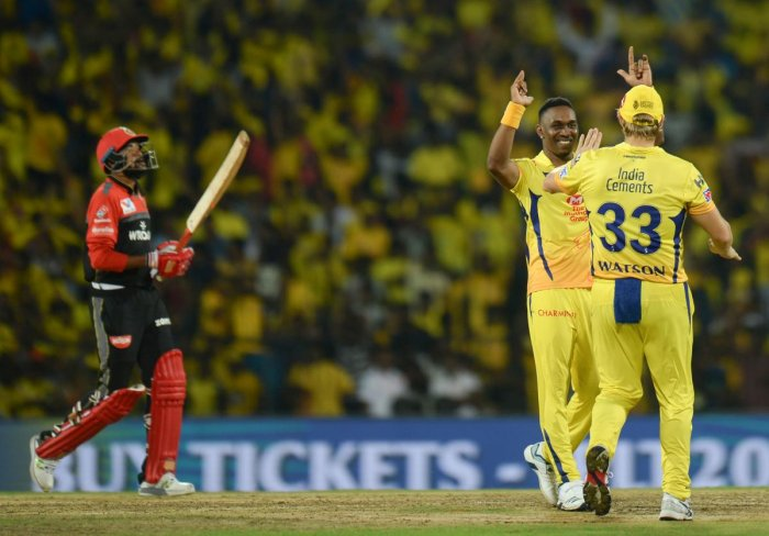 Chennai Super Kings cricketer Dwayne Bravo (C), Shane Watson (R) celebrates a wicket of Royal Challengers Bangalore's Parthiv Patel during the Indian Premier League (IPL) Twenty20 cricket match between Chennai Super Kings and Royal Challengers Bangalore a