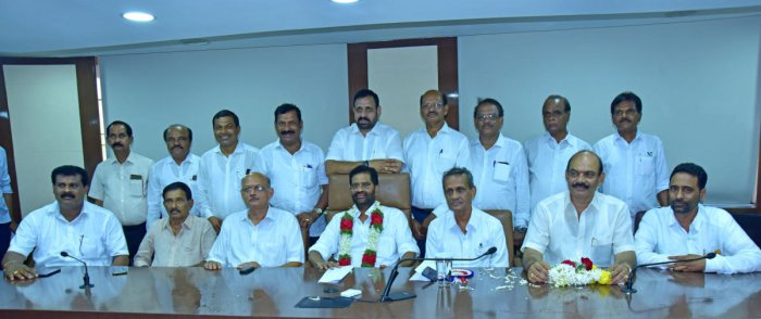 SCDCC Bank President M N Rajendra Kumar and newly elected members seen at meeting hall in Mangaluru. DH Photo