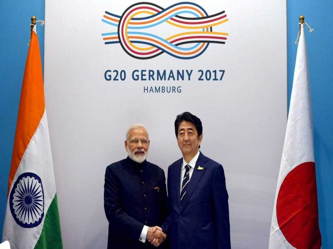 Modi, Abe review progress in ties ahead of Malabar exercise