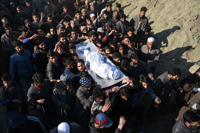 Kashmiri villagers carry a charred body of a twelve-year-old boy, Aatif Mir, during a funeral procession in Hajin area, in Bandipora district of Kashmir. AFP