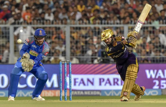 Kolkata Knight Riders' captain Dinesh Karthik drives one to the fence en route to his 52. PTI