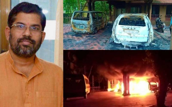 Swami Sandeepananda Giri and the charred vehicles in front of the ashram. (Courtesy: Facebook)