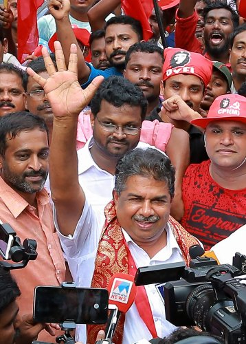 Left Democratic Front candidate Saji Cherian celebrates after winning the Chengannur Assembly bypoll by a huge margin of 20,956 votes. PTI