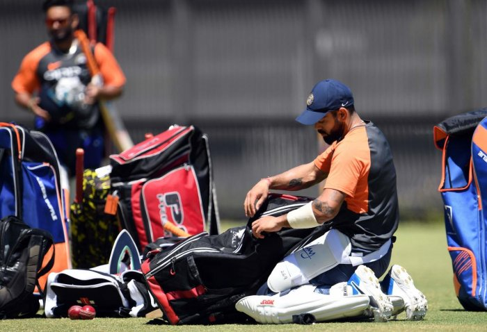 India's captain Virat Kohli packs up his cricket kit during a training session in Perth on December 13, 2018. (Photo by WILLIAM WEST / AFP)