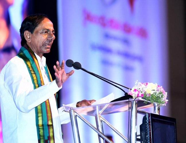 KCR addressing the preparatory meeting on farmers life insurance at Hitex in Hyderabad. DH Photo